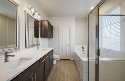 Townhome bathroom with tub and shower plus double sinks