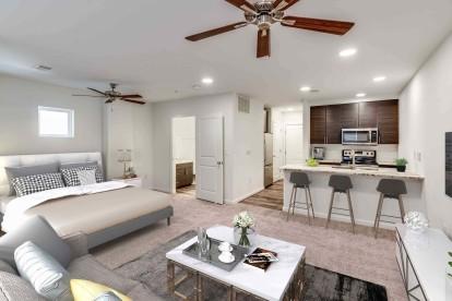 Kitchen and bedroom in studio floor plan