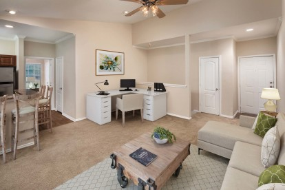 Top floor living room with carpet and space for a home office
