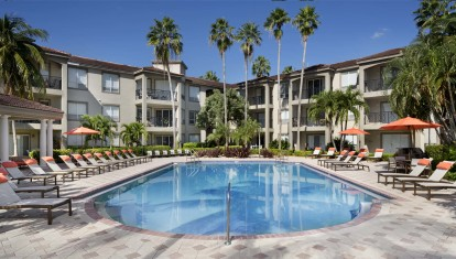 Pool overlooking marina with expansive deck space and lounging areas