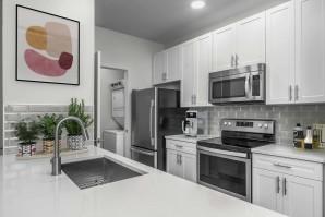 Kitchen with white quartz countertops