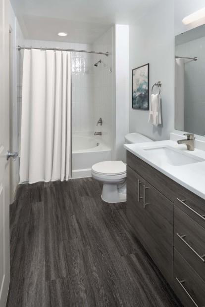 Bathroom with wood-style flooring and bathtub