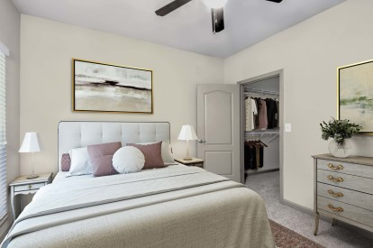 Bedroom with walk in closet and carpet flooring
