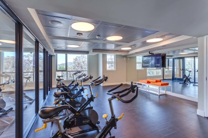 24 hour fitness center stationary bike room with on demand virtual trainer