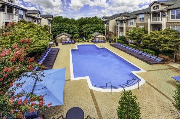 Pool deck with lounge chairs outdoor dining and barbeques