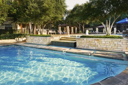 Resort style swimming pools with water feature