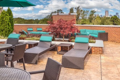 Rooftop terrace with stunning uptown Charlotte views and fireplace