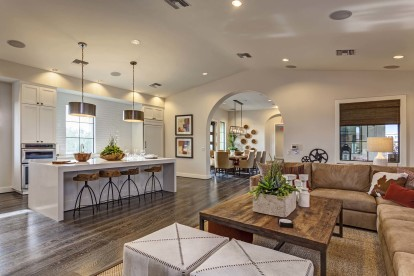 Resident dining lounge with barstool seating chefs kitchen and dining areas