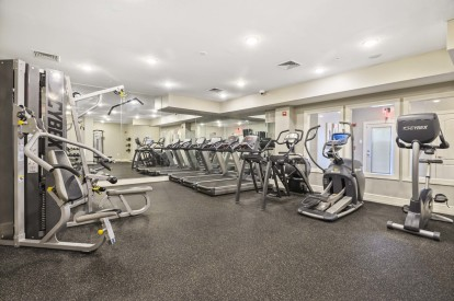 Fitness center with cardio and weight training equipment cybex