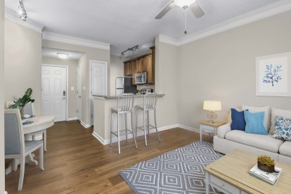 Living, dining, and kitchen with hardwood-style-flooring