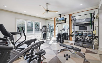 24 hour fitness center with trx and strength training equipment