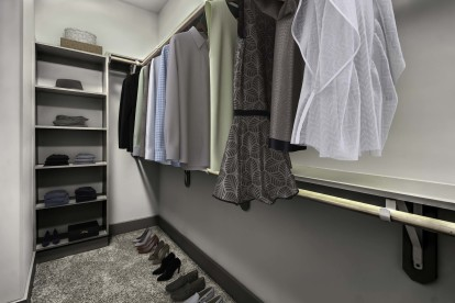 Spacious closet with built in wooden shelves