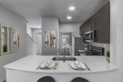 Townhome floor plan kitchen with quartz countertops stainless steel appliances and undermount sink