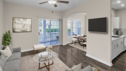Living, dining room, and kitchen with balcony at Camden Governors Village Apartments in Chapel Hill, NC