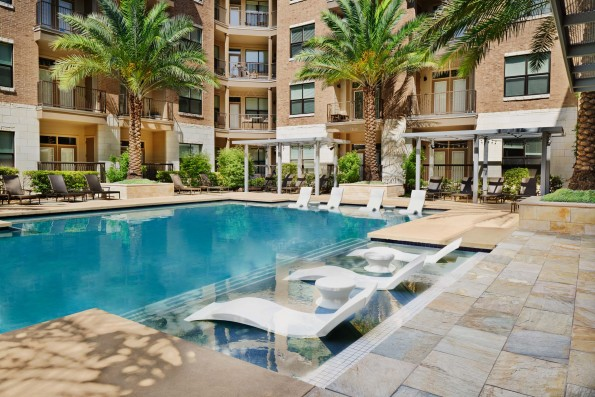 Resort style pool with in water lounge chairs