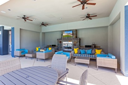Outdoor lounge with tv and fireplace and ceiling fans and seating and dining areas