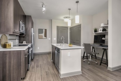 Kitchen with island dishwasher and glass cooktop with flex space