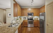 Kitchen with glass cooktop and granite countertops