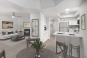 Open-concept dining area near kitchen with white quartz countertops