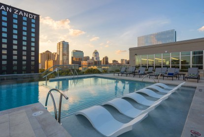 Rooftop pool with views of downtown skyline