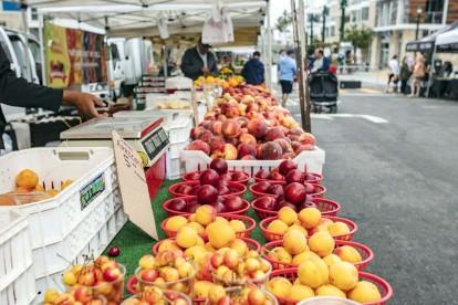 Farmers market in little italy neighborhood near community