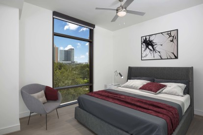 Bright contemporary finishes bedroom with skyline views