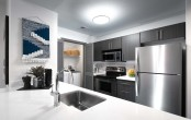 Modern style kitchen with stainless steel appliances and white quartz countertops