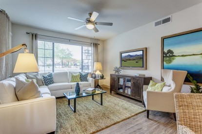 Living area with ceiling fan and wood style floor