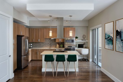 Gallery kitchens with light wood cabinets, subway tile backsplash, and built in desks