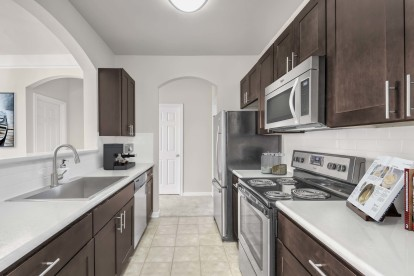 Galley kichen with stainless steel appliances