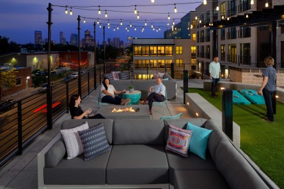 Rooftop Lounge with string lights, fire pits and yard games