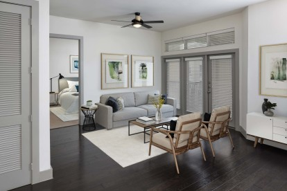 The terrace living room with wood flooring ceiling fan and access to a private balcony