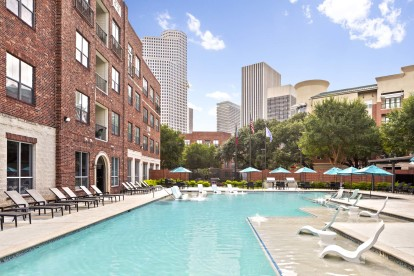 Midtown pool with lounge chairs view of downtown