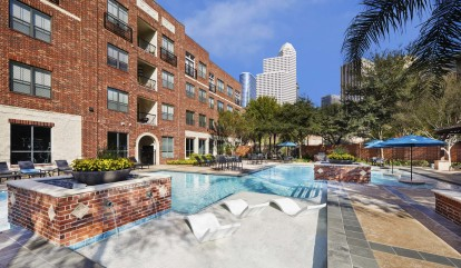 Midtown pool with lounge chairs view of downtown and tanning deck