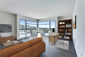 Living dining workspace floor to ceiling windows