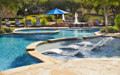 Resort style pool with lounge chairs