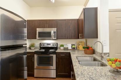 Kitchen with granite countertops undermount sink and espresso cabinets
