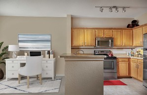 Open kitchen with stainless steel appliances and space for home office