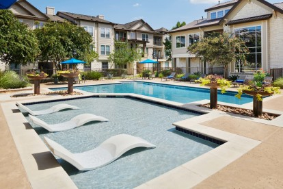 Resort style pool with in water pool loungers