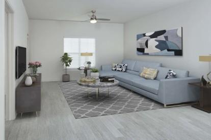 Modern garden apartment living room with hardwood style floors