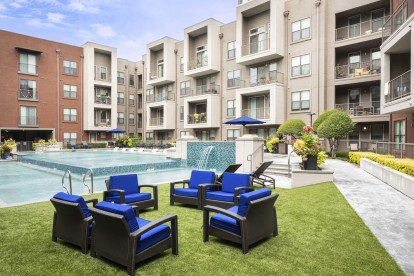 Poolside outdoor courtyard with seating