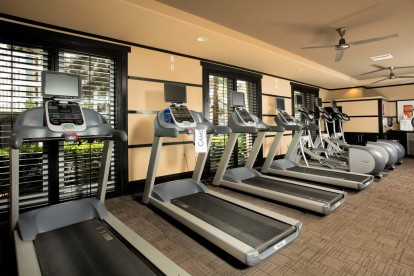 Fitness center cardio equipment and ceiling fans