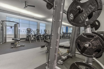 Motion fitness studio with free weights strength training and cardio equipment