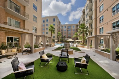 Poolside courtyard with seating and cabanas