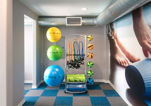 Fitness center with stability balls and strength training bands