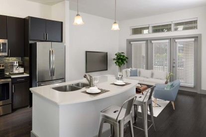 The terrace with open-concept kitchens and living spaces with access to a private balcony