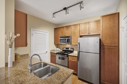 Kitchen with electric coil cooktop and stainless steel appliances