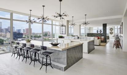 Sky lounge kitchen with skyline views