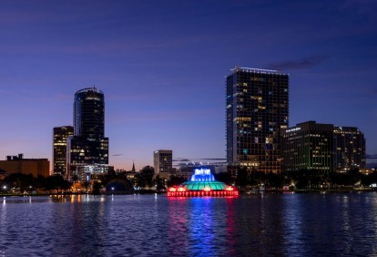 Lake eola nighttime fountain and downtown