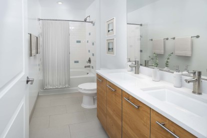 Bathroom with double vanity at Camden South Capitol